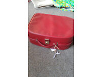 Vintage red vanity case. Lockable with original key