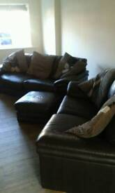 Brown leather settees and foot stool