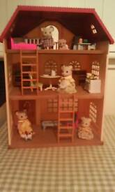 Sylvanian mouse family and house with furniture.