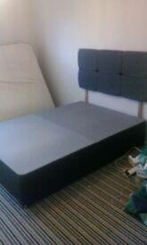 grey double divan and heafboard