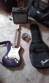 Fender Squire Strat guitar and Fender amplifier.