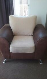 Big arm chair with chrome feet good condition smoke free home . Suede and fabric