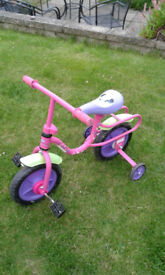 Toddler's tricycle with stabilisers.
