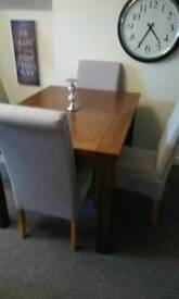 New Solid oak table and 4 oak chairs