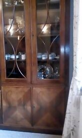 "Lovely ""rosewood"" glass fronted display cabinet with two shelves in lower cupboard. Only £95.00"
