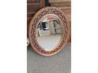Vintage decorative oval mirror.