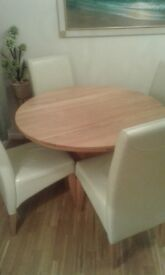 round oak table with 4 chairs