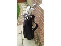 A selection of used golf clubs sold as set or indv.