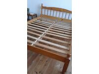 Double bed, wooden headboard and frame, brand new mattress.