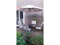 Strong Metal Patio Set. 4 Chairs, 100 cm Granit topped Table, Parasol, Seat Cushions