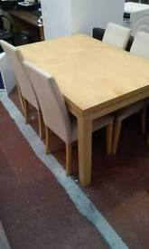 Previously loved extending table and four chairs