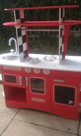 mothercare red wooden kitchen