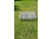 Galvanised steel dog crate with tray in good condition with two openings.