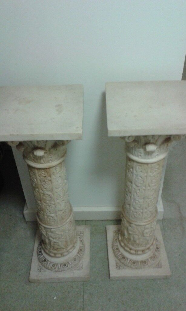 A pair of resin pilasters