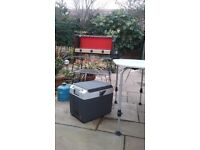 Adjustable leg camping table, electric cool box, camp kitchen, stove with 2 gaz cyllinders
