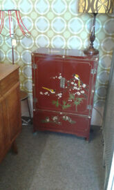Oriental style Cabinet. Loads of beautiful painted detail on this oriental style cabinet