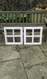 Hardwood windows 20inches square approx, unused in primer.