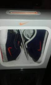 Nike First Court Trainers