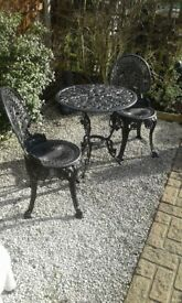 Garden table and 2 chairs metal very heavy