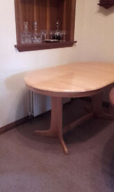 Dining Table in Light Colour Solid Wood with internal extension in excellent condition