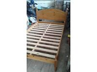 Small double pine bed frame and mattress.