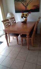Oak extendable table with 8 chairs