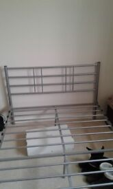 Small double metal bed frame with optional mattress