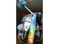 Large plastic basin full of household stuff: wood floor cleaner, antifreeze, de-icer, extensions etc