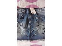 short denim skirt with stud on. Teenage/young girl