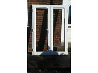 White UPVC French doors with double glazed units in excellent working order