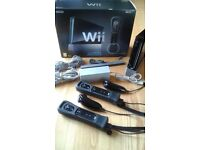 Nintendo Wii, includes games & accessories