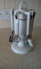 Kitchen utensils carousel. White with red trim. Nice quality