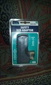 Brand new. Safety rcd adaptor plug.