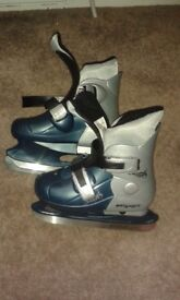 Kids ice skates used once.Immaculate condition.Size 29 -32.