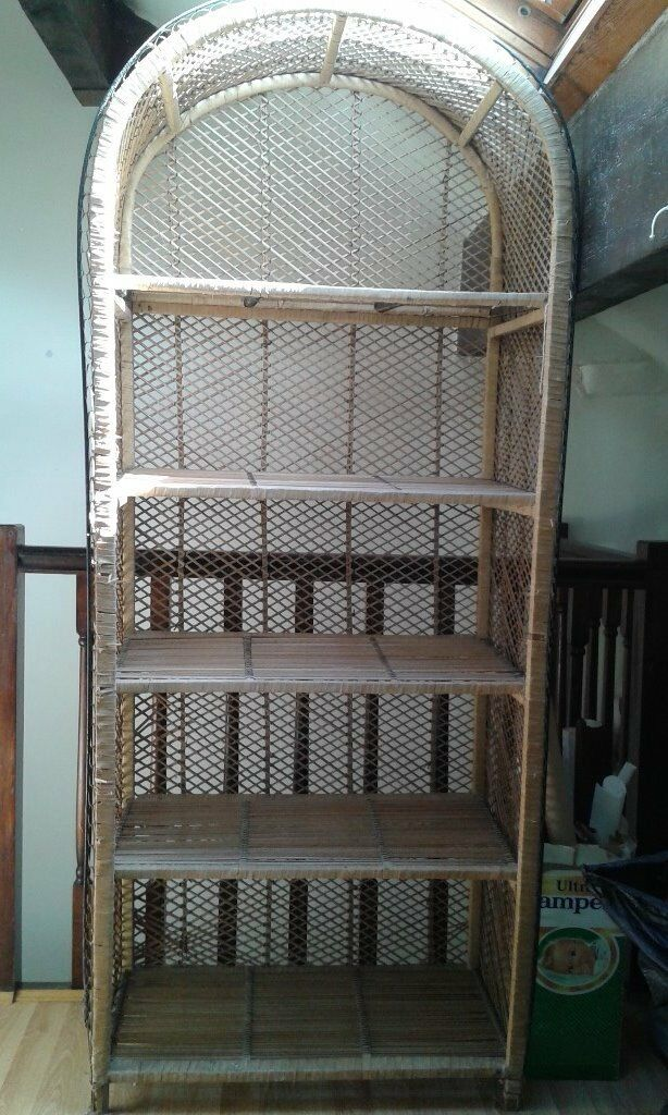 Two rattan shelf units, one with cupboard doors in the lower section.