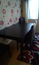 Black ash extension table with 6 chairs