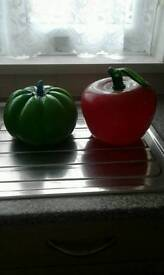 Glass tomato and green pepper.