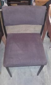 Three strong upright backs material chairs not matching.