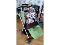 Mama's and Papa's sola green pushchair, car seat and accessories