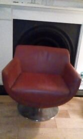 Red leather contemporary style childs swivel chair. A quality piece and in good in condition. .