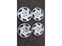 """Four 14"""" Peugeot Wheel Trims"""