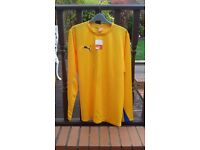 Youth football puma shirts, 16 numbered 2 - 17 in yellow