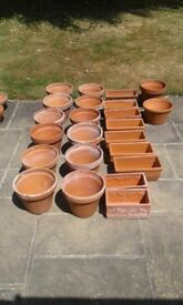 14 round clay pots, 9 long planters