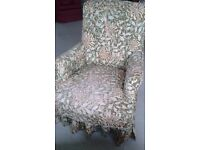 Lovely Victorian Armchair in good condition. Has a William Morris loose cover.