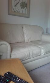 bargain great condition 3 seater cream leather sofa and matching foot stool