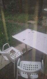 Garden table with chairs for sale.