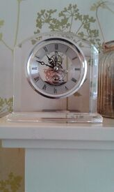 London clock company skeleton clock in glass mount. Mantlepiece.