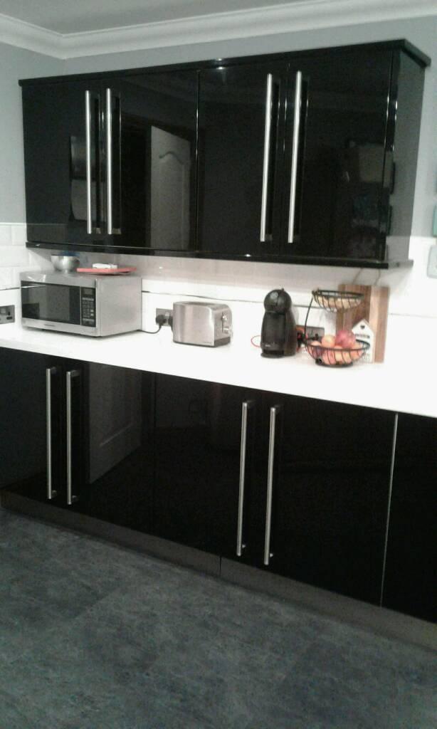 Black Gloss Kitchen Units And White Worktop
