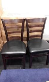 Pair of faux leather and wooden backed chairs