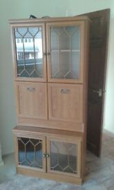 Dining cupboard with nice glass doors.